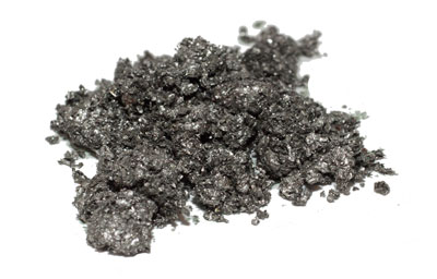 a pile of grainy tin particles on a white surface